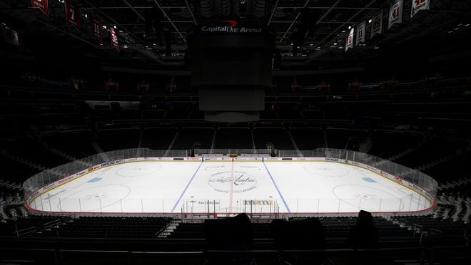 Capital One Arena, home of the Washington Capitals NHL hockey club in Washington. Get used to the concept of pods and pucks if the NHL is going to have any chance of completing its season, with the most likely scenarios calling for games in empty, air-conditioned arenas during the dog days of summer.