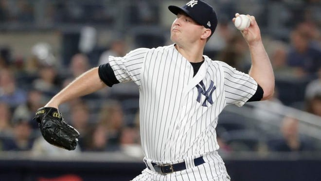 New York Yankees reliever Zach Britton delivers a pitch during the seventh inning of a baseball game against the Baltimore Orioles Friday, Sept. 21, 2018, in New York.