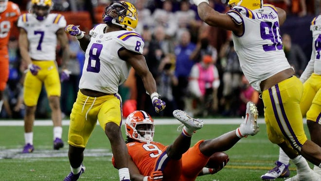 From Jan. 13, 2020, LSU linebacker Patrick Queen celebrates after tackling Clemson running back Travis Etienne during the second half of the NCAA College Football Playoff national championship game in New Orleans. Queen was selected by the Baltimore Ravens during the first round of the NFL draft.