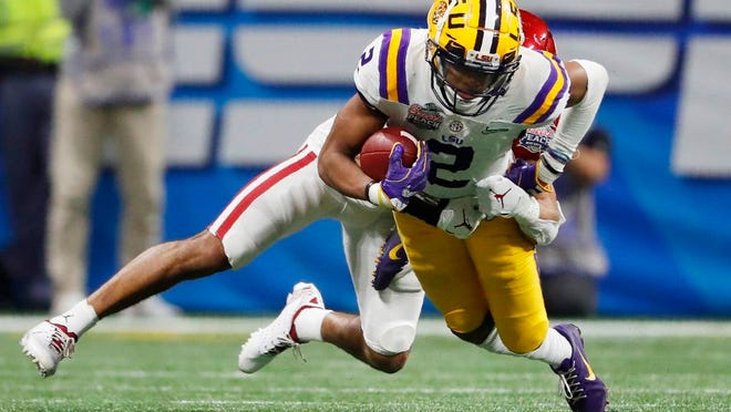 From Dec. 28, 2019, LSU wide receiver Justin Jefferson (2) runs against Oklahoma cornerback Woodi Washington (5) during the second half of the Peach Bowl NCAA semifinal college football playoff game in Atlanta. This year's NFL draft features a superb group of wide receivers, including Jefferson, who are expected to make immediate impacts in the NFL.