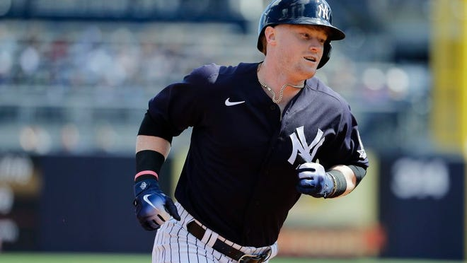 New York Yankees' Clint Frazier runs the bases after hitting a home run during the first inning of a spring training baseball game against the Tampa Bay Rays Thursday, Feb. 27, 2020, in Tampa, Fla.