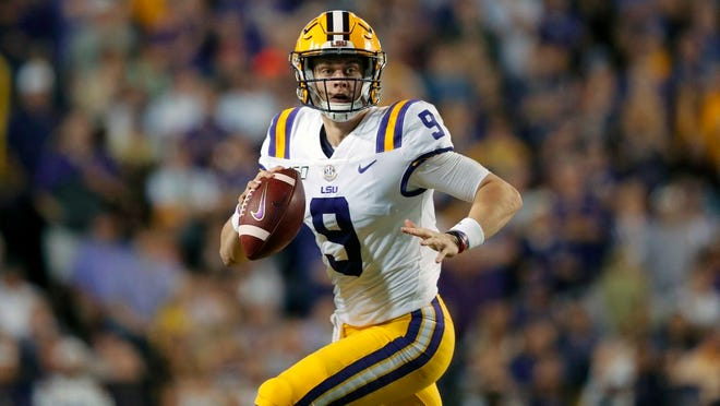 From Nov. 30, 2019, LSU quarterback Joe Burrow (9) scrambles during the first half of an NCAA college football game against Texas A&M in Baton Rouge, La. Burrow is a posible first round pick in the NFL Draft Thursday night, April 23, 2020.