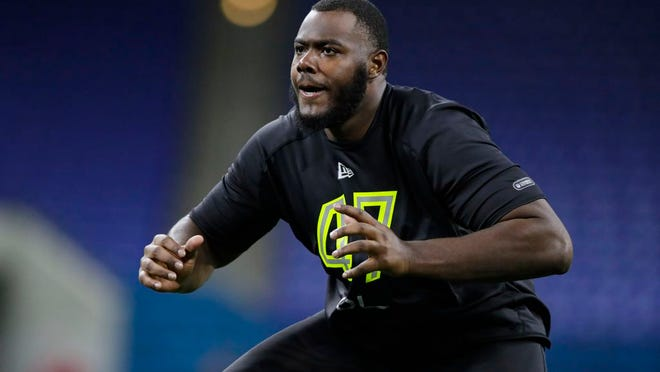 From Feb. 28, 2020, Georgia offensive lineman Andrew Thomas runs a drill at the NFL football scouting combine in Indianapolis. The New York Giants selected Thomas with the fourth pick in the NFL draft Thursday, April 23.