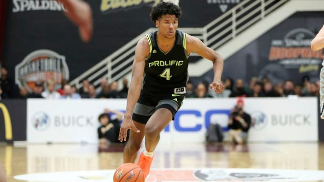 From Jan. 19, 2020, Prolific Prep's Jalen Green dribbles against La Lumiere during a high school basketball game at the Hoophall Classic in Springfield, Mass. The G League's plan to sign elite players and offer them a spot in a one-year program that will prep them for the NBA draft is making a splash.