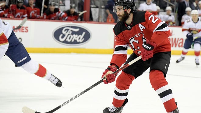 New Jersey Devils right wing Kyle Palmieri (21) looks to pass the puck during the second period of an NHL hockey game against the Florida Panthers Tuesday, Feb. 11, 2020, in Newark, N.J.