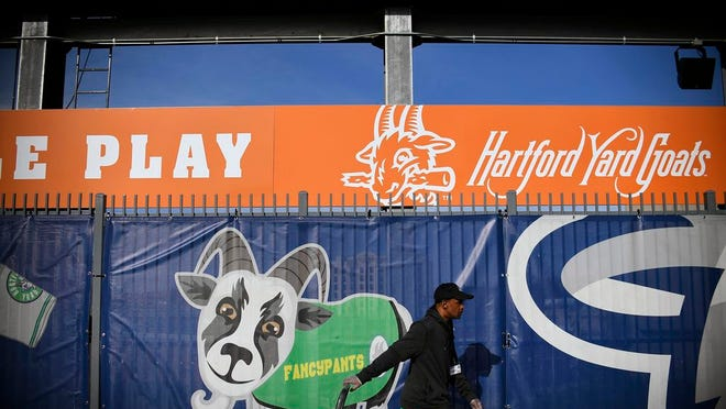 From April 16, 2019, a Hartford Yard Goats employee pulls a cart through the picnic pavilion area in the outfield of Dunkin' Donuts Park before a game between the Yard Goats and Richmond Flying Squirrels in Hartford, Conn.