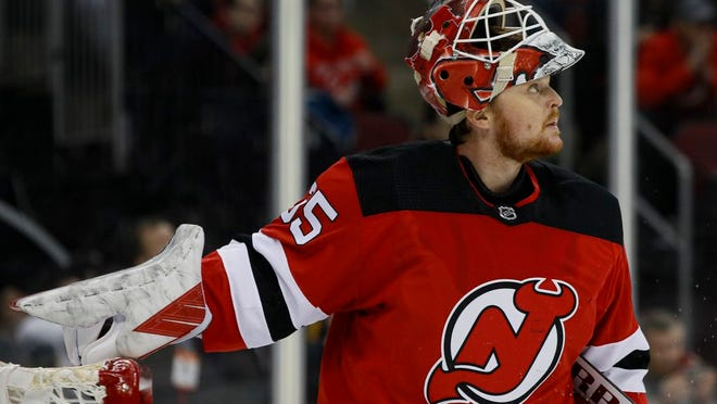 New Jersey Devils goaltender Cory Schneider reacts after giving up a goal to St. Louis Blues defenseman Vince Dunn during the first period of an NHL hockey game, Friday, March 6, 2020, in Newark.