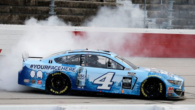 Kevin Harvick does a burnout after winning the NASCAR Cup Series race in Darlington. It was Harvick's 50th career win as NASCAR's return from coronavirus pandemic {THE ASSOCIATED PRESS]