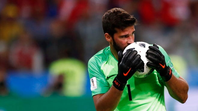 From June 27, 2018, Brazil goalkeeper Alisson kisses the ball after makes a save during their World Cup soccer match against Serbia. There will be no more kissing the ball for good luck in South American soccer. Forget about exchanging jerseys and even spitting or blowing noses on the field also. The soccer governing body of soccer in the region has released a series of specific regulations amid the coronavirus pandemic to protect everyone's health when the Copa Libertadores eventually resumes. There is no date set for when the tournament will restart.