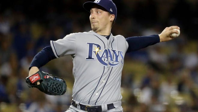 "From Sept. 17, 2019, Tampa Bay Rays starting pitcher Blake Snell throws to a Los Angeles Dodgers batter during the first inning of a baseball game in Los Angeles. Rays All-Star pitcher Blake Snell says he  will not take the mound this year if his pay is cut further, proclaiming: ""I'm not playing unless I get mine."" the 2018 AL Cy Young Award winner said on a Twitch stream Wednesday, May 14 2020."