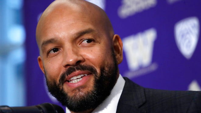 From Dec. 3, 2019, Washington NCAA college football defensive coordinator Jimmy Lake speaks during a news conference about taking over the head coaching position, in Seattle. Just when it seemed like things were up and rolling, the COVID-19 pandemic hit. The ensuring national shutdown hurt coaches across college football as they prepare for next season, but it was particularly difficult on programs with first-year coaches trying to build something from the ground up.
