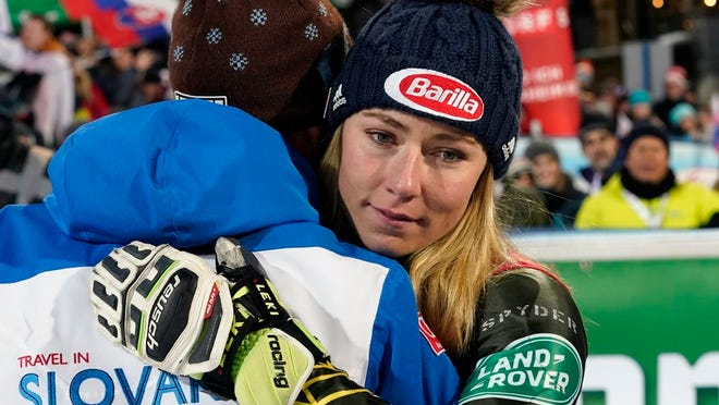 From Jan. 14, 2020, United States' Mikaela Shiffrin embraces Italy's Livio Magoni, coach of Slovakia's Petra Vlhova, after completing an alpine ski women's World Cup slalom race in Flachau, Austria. When she's not winning races, two-time Olympic champion Mikaela Shiffrin unplugs by singing and playing guitar. Music was always a bond she shared with her late father, Jeff, who died on Feb. 2 after an accident at his home in Edwards, Colorado.
