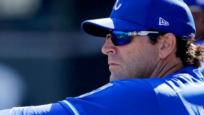 From Feb. 24, 2020, Kansas City Royals manager Mike Matheny watches from the dugout during the second inning of a spring training baseball game against the San Diego Padres in Surprise, Ariz. The Royals had an entire offseason and most of spring training to get to know Mike Matheny. But one unintended consequence of the coronavirus pandemic is they've gotten to know their new manager better than they could ever have imagined.