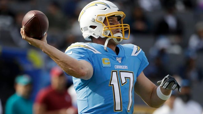 From Dec. 22, 2019, Los Angeles Chargers quarterback Philip Rivers passes against the Oakland Raiders during the first half of an NFL football game in Carson, Calif. The Indianapolis Colts bet big on 38-year-old Philip Rivers. They're hoping the $25 million investment in a new starting quarterback pays off with a playoff appearance and perhaps Super Bowl run. Colts coach Frank Reich insists he's seen no physical decline in the eight-time Pro Bowler.