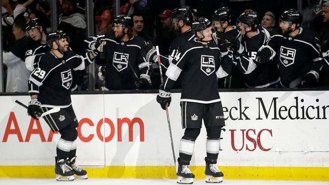From March 9, 2020, Los Angeles Kings' Mikey Anderson, right, celebrates his goal with teammates during the first period of an NHL hockey game against the Colorado Avalanche, in Los Angeles. The Los Angeles Kings were the NHL's hottest team before the coronavirus pandemic ended the regular season prematurely. They're hoping they can eventually build on that success whenever they get back on the ice.