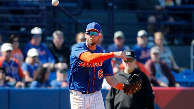 New York Mets third baseman Jeff McNeil throws to first during the fifth inning of a spring training baseball game against the St. Louis Cardinals Friday, Feb. 28, 2020, in Port St. Lucie, Fla.