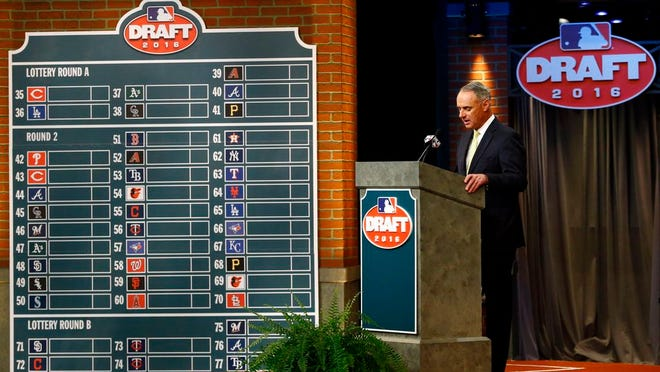 From June 9, 2016, Major League Baseball Commissioner Rob Manfred speaks during the MLB draft, in Secaucus, N.J. Major League Baseball will cuts its amateur draft from 40 rounds to five this year, a move that figures to save teams about $30 million. Clubs gained the ability to reduce the draft as part of their March 26 agreement with the players' association and MLB plans to finalize a decision next week to go with the minimum, a person familiar with the decision told The Associated Press. The person spoke Friday, May 8, 2020, on condition of anonymity because no decision was announced.