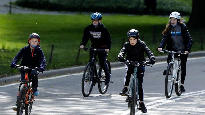 From May 9, 2020, file photo, youngsters ride bicycles through Central Park in New York. Bicycling is seeing an increase in participation since the coronavirus outbreak began taking off in the United States.