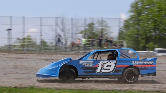 Gabe Wilkins drives his car during a practice session at Gas City I-69 Speedway, Sunday, May 24, 2020, in Gas City, Ind.