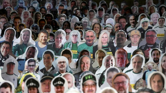 Cardboard pictures of fans ahead the German first division Bundesliga football match Borussia Moenchengladbach and Bayer 04 Leverkusen on Saturday, May 23, 2020 in Moenchengladbach, western Germany.