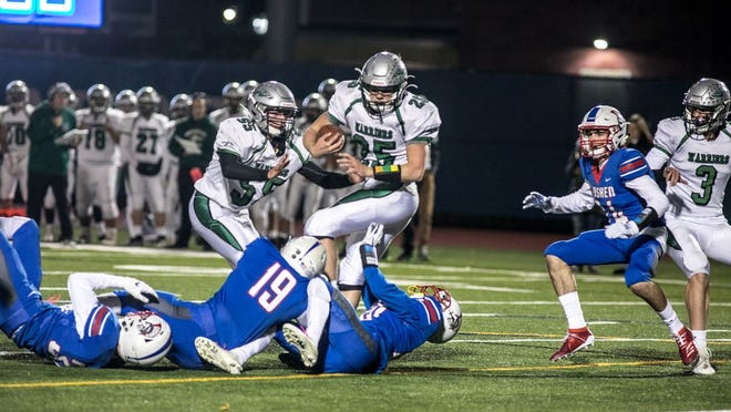 Minisink's Kyle Killenberger, center runs the ball in a Minisink vs Goshen Football game in Middletown, NY on November 1, 2019. ALLYSE PULLIAM/For the Times Herald-Record