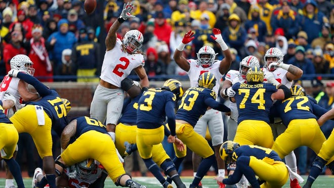 Ohio State defensive end Chase Young (2) tries to block a Michigan place kicker Quinn Nordin (3) field goal in the second half of an NCAA football game in Ann Arbor, Mich., Saturday, Nov. 30, 2019.