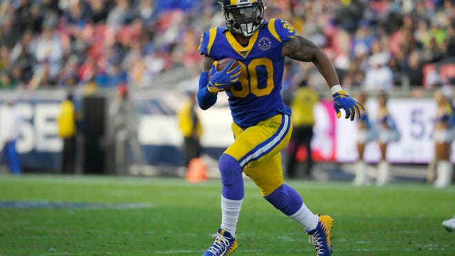 From Dec. 29, 2019, Los Angeles Rams running back Todd Gurley runs a play during the first half of an NFL football game against the Arizona Cardinals, in Los Angeles. The Atlanta Falcons have agreed to a one-year deal with three-time Pro Bowl running back Todd Gurley, one day after he was cut by the Los Angeles Rams. A person familiar with the deal told The Associated Press about the agreement on Friday, March 20, 2020, on condition of anonymity because the deal will not be official until Gurley passes a physical.