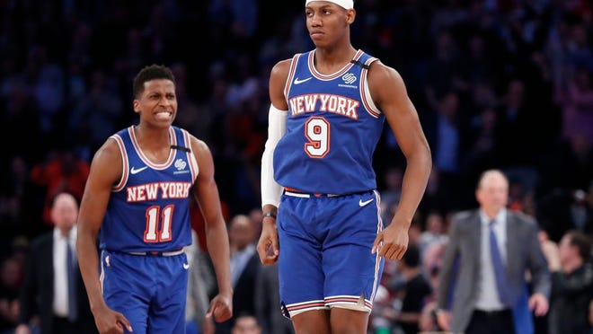 New York Knicks guard Frank Ntilikina (11) had a tough season and guard RJ Barrett (9) enjoyed a solid one.