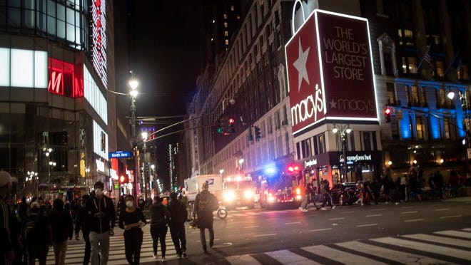 New York police officers park their vehicles outside Macy's store after it was broken into hours after a solidarity rally calling for justice over the death of George Floyd, Monday, June 1, 2020, in New York. Floyd died after being restrained by Minneapolis police officers on May 25.
