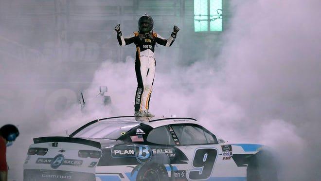 Noah Gragson celebrates after winning a NASCAR Xfinity Series race at Bristol Motor Speedway. MARK HUMPHREY/AP