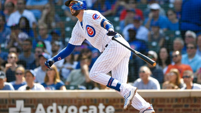 FILE - In this Sept. 15, 2019, file photo, Chicago Cubs' Kris Bryant watches his three-run home run during the first inning of a baseball game against the Pittsburgh Pirates in Chicago. Bryant avoided arbitration with the Cubs, agreeing Friday, Jan. 10, 2010, to an $18.6 million, one-year contract, a person familiar with the situation told The Associated Press. The person spoke on the condition of anonymity because the deal had not been announced.