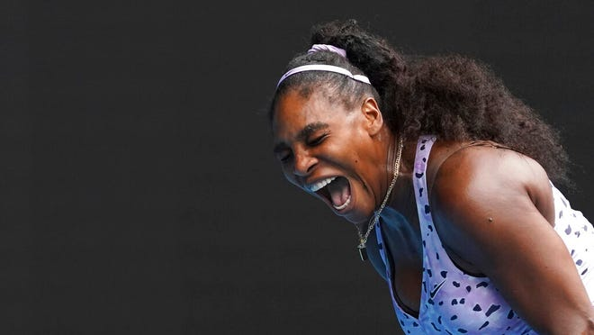Serena Williams of the U.S. reacts as she plays China's Wang Qiang in their third round singles match at the Australian Open tennis championship in Melbourne, Australia, Friday, Jan. 24, 2020.