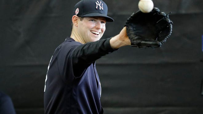 New York Yankees' Jordan Montgomery smiles during a spring training baseball workout Thursday, Feb. 13, 2020, in Tampa, Fla.