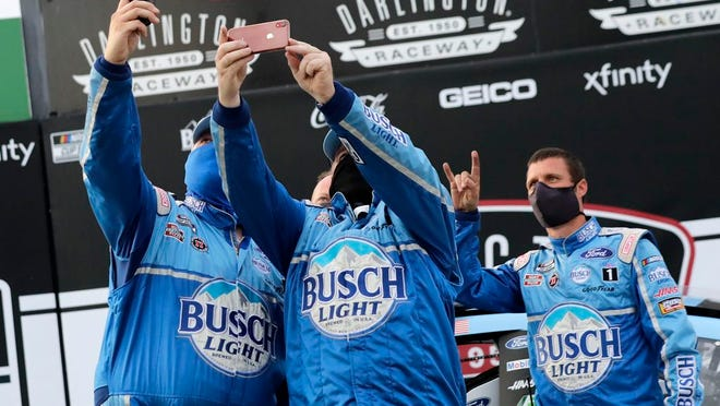 Members of Kevin Harvick's team celebrate after winning the NASCAR Cup Series auto race Sunday, May 17, 2020, in Darlington, S.C.