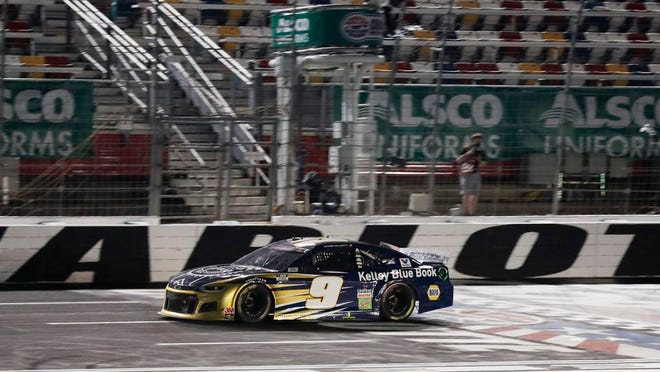 Chase Elliott crosses the finish line as he wins a NASCAR Cup Series race at Charlotte Motor Speedway. THE ASSOCIATED PRESS