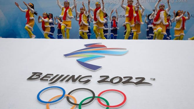 From Feb. 27, 2018, Chinese performers dance during a ceremony to mark the arrival of the Olympic flag and start of the flag tour for the Winter Olympic Games Beijing 2022 at a section of the Great Wall of China on the outskirts of Beijing. Uncertainty surrounds how the postponed Tokyo Olympics will be held next year in the midst of the coronavirus. The same questions permeate three mega-events that will be staged in China within a year after the Tokyo Games close.