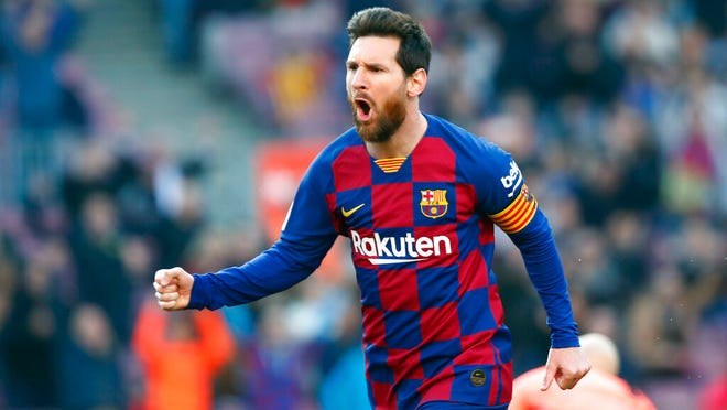 From Feb. 22, 2020, Barcelona's Lionel Messi celebrates after scoring his side's opening goal during a Spanish La Liga soccer match between Barcelona and Eibar at the Camp Nou stadium in Barcelona, Spain. panish Prime Minister Pedro Sánchez announced Saturday, May 23, 2020 that the soccer league in Spain will be allowed to resume from June 8.  While the top tier, La Liga, can play from this date, it has already said it wants to resume play on June 12. It is unclear when the first games will be held. There has been no play in the top tier since March 12 due to the coronavirus crisis.