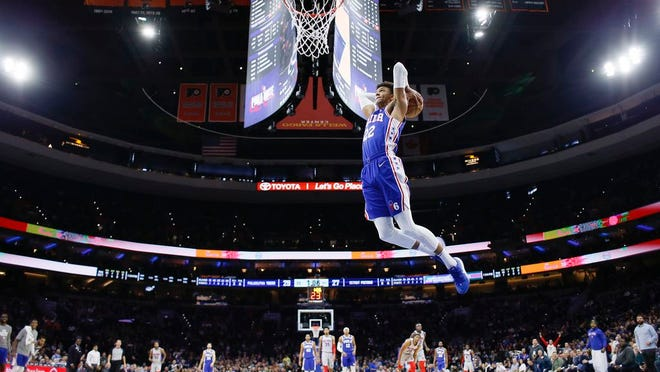 Philadelphia 76ers' Matisse Thybulle (22) goes up for a dunk during the first half of an NBA game against the Detroit Pistons, Wednesday, March 11, 2020, in Philadelphia.