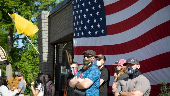 A few dozen protesters participate in a NY Freedom Rally in front of Casa Di Dolore Tattoo shop in Newburgh, NY on May 30, 2020.  ALLYSE PULLIAM/For the Times-Herald Record