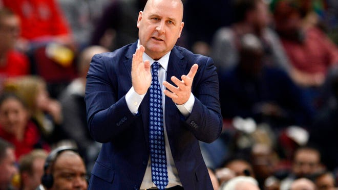 From March 10, 2020, Chicago Bulls coach Jim Boylen cheers on players during the first half of the team's NBA basketball game against the Cleveland Cavaliers in Chicago. Boylen's future is the biggest issue hanging over the Bulls, who were left out when the NBA's Board of Governors approved a 22-team format to restart the pandemic-interrupted season next month in Orlando.