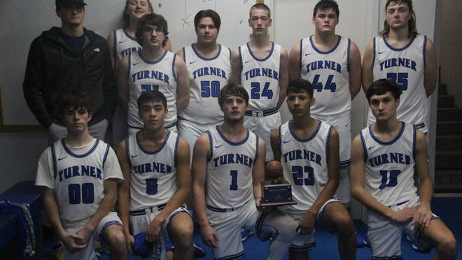 Members of the Turner Falcons basketball team pose together for a team photo after winning third place in the Bulldog Bash tournament on Saturday in Healdton.