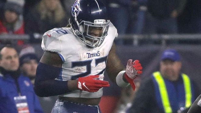Tennessee Titans running back Derrick Henry celebrates his touchdown against the New England Patriots in the first half of an NFL wild-card playoff football game, Saturday, Jan. 4, 2020, in Foxborough, Mass.