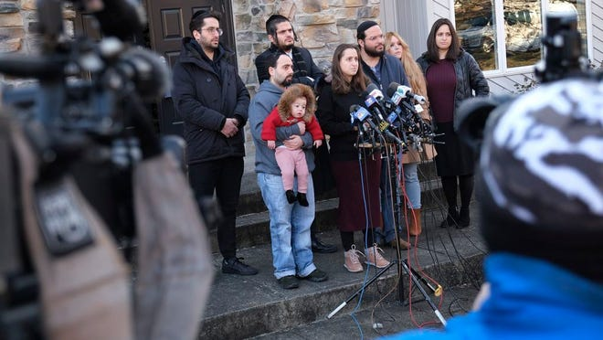 Surrounded primarily by family, Nicky Kohen, the daughter of Josef Neumann who was critically injured in an attack on a Hanukkah celebration, speaks to reporters in front of her home in New City, N.Y., Thursday, Jan. 2, 2020. Kohen told reporters she hopes her father regains consciousness and finds a changed world while making an emotional plea to end hatred and anti-Semitism. Her 72-year-old father has been unconscious since he was wounded Saturday in a machete attack at a rabbi's home in Monsey, N.Y.