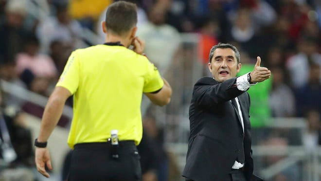 Barcelona's head coach Ernesto Valverde, right, shouts out from the touchline during the Spanish Super Cup semifinal soccer match between Barcelona and Atletico Madrid at King Abdullah stadium in Jiddah, Saudi Arabia, Thursday, Jan. 9, 2020.