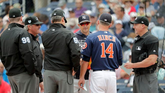 New York Yankees manager Aaron Boone (17) center, and Houston Astros manager AJ Hinch (14) meet at home plate before an exhibition spring training baseball game against on Wednesday, March 20, 2019, in West Palm Beach, Fla.