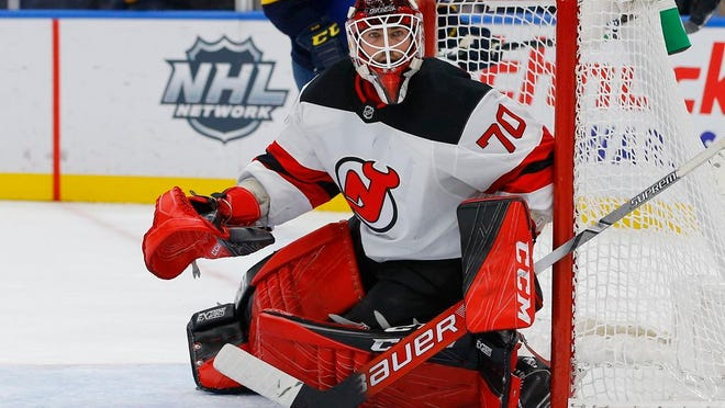 Devils goaltender Louis Domingue defends the net during the second period against the Blues.