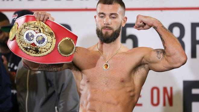 IBF super middleweight champion Caleb Plant poses during the weigh-in for his fight against Vincent Feigenbutz Friday, Feb. 14, 2020, in Nashville, Tenn. The fight is scheduled for Saturday, Feb. 15.