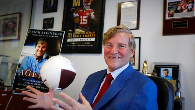 Sports agent Leigh Steinberg poses for a picture at his office Thursday, Feb. 13, 2020, in Newport Beach, Calif. A decade after his personal and professional life bottomed out, Steinberg has another Super Bowl MVP client, saw another former client be elected to the Pro Football Hall of Fame and could have yet another first-round draft pick in the spring.