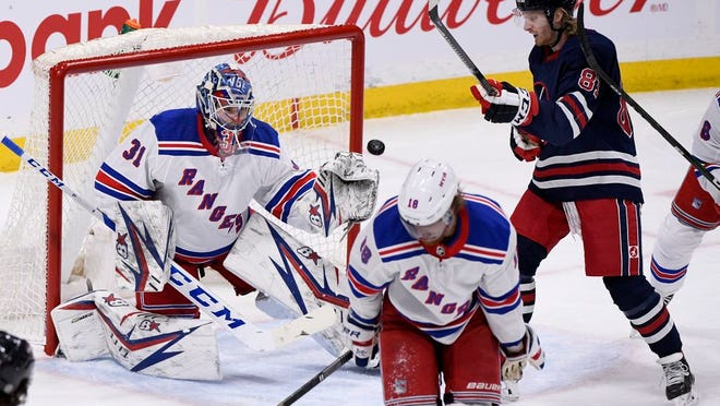 New York Rangers goaltender Igor Shesterkin (31) makes a save on a Winnipeg Jets shot as Kyle Connor (81) looks for the rebound during first period NHL hockey action in Winnipeg, Manitoba on Tuesday Feb. 11, 2020.