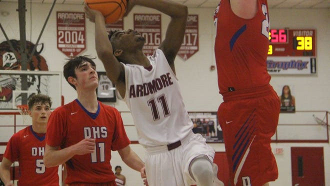 Ardmore's EJ Cohee goes up for a shot in the middle of a pair of Durant defenders during the second half Tuesday night at the Ardmore High School Gymnasium.